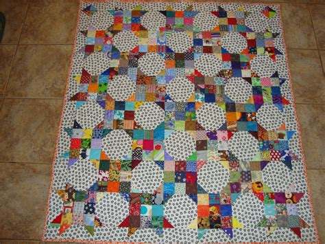 scrappy 9 patch and snowball quilt from 2 5 quot squares