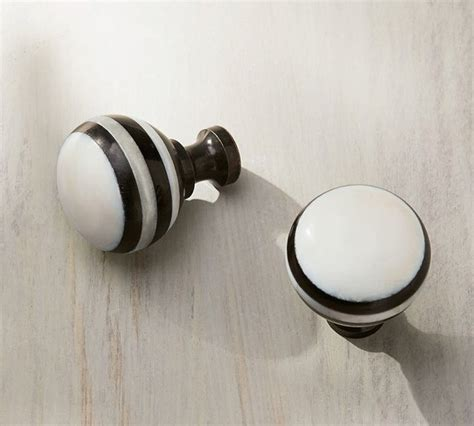 black and white knob cabinet and drawer