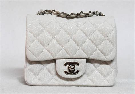 Conrad Sports A New Do A Chanel Caviar Bag by New Chanel Mini Flap White Caviar Leather Messenger Bag