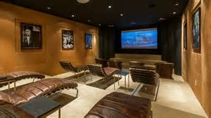 Luxury with gold walls and leather chairs the three tiered room