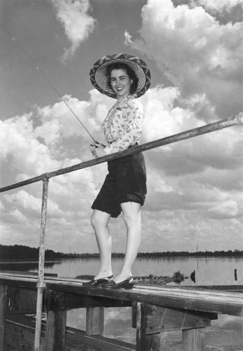 Florida Memory - Marjorie King fishing from a pier on the