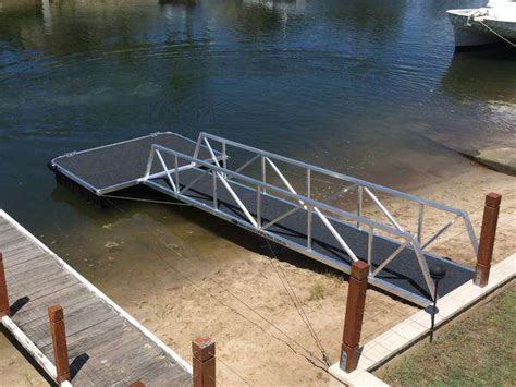 fishing boat vs pontoon pontoons vs jetties and the difference in pile types