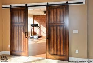Sliding barn door hardware for double doors