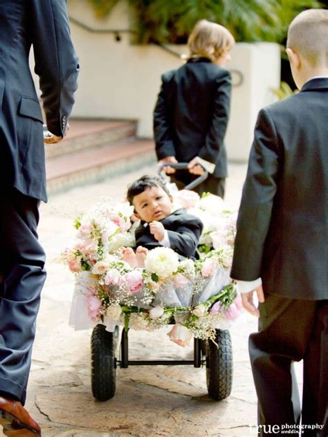 such a cute way to introduce the mini ring bearer just