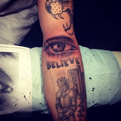 justin bieber arm tattoos justin bieber adds an eye to his almost sleeve