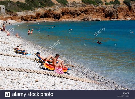 agios nikolaos crete greece beach sunbathers on beach plaka near elounda agios nikolaos