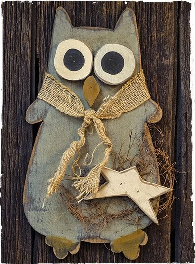 large hanging wooden owl about primitive crafting