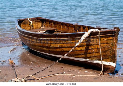 sea rowing boats for sale uk wooden rowing boat on beach stock photos wooden rowing