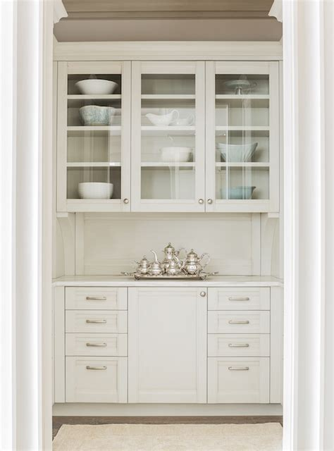 butlers pantry with glass front cabinets transitional