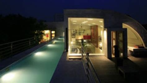 a sleek modern home with indian sensibilities and an a gorgeous home split by a covered garden atrium