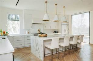 kitchen white kitchen with laminate floor and marble