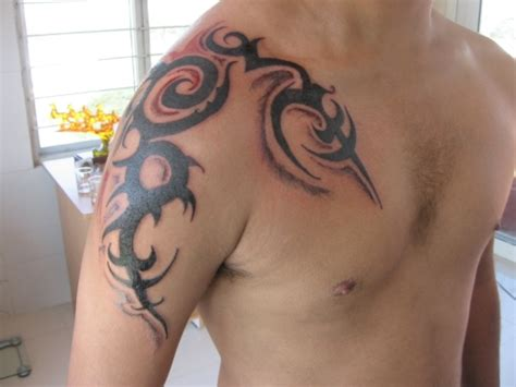 tribal tattoos chest arm shoulder 25 tribal shoulder tattoos which are awesome creativefan