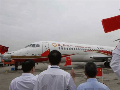 first airplane ever made made in china airliner makes first ever commercial flight