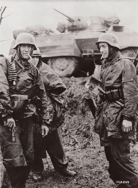 wwii german ss soldiers german soldiers smoke captured american cigarettes in
