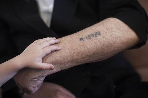 tattoo numbers auschwitz state expands holocaust survivor benefit eligibility the