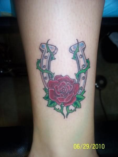 horseshoe and rose tattoo and shoe