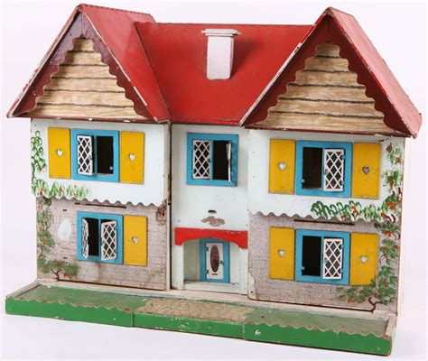 triang dolls house catalogue a 1960s red roof tri ang toys dolls house with yellow heart shutters two front