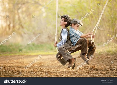 swing swing swing on a summer day two young children on swing sunny stock photo 251219917
