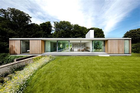 design house uk wetherby modern house cantilevers over stone wall in england curbed