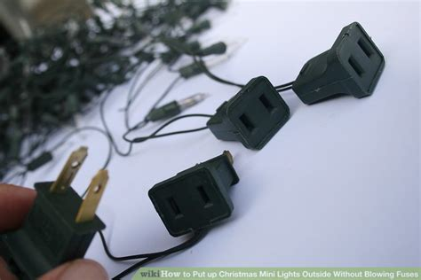 how to put up christmas mini lights outside without