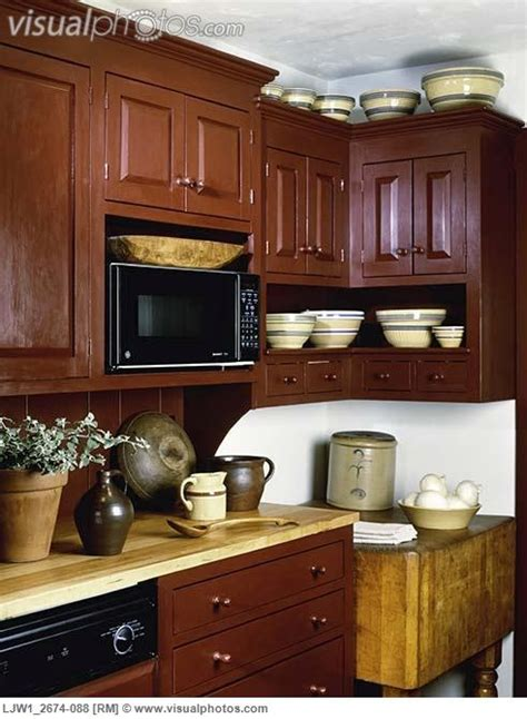 Cranberry Kitchen Cabinets Kitchen Contemporary Period Country Antique Pottery And Wooden Ware On Maple Counter Top