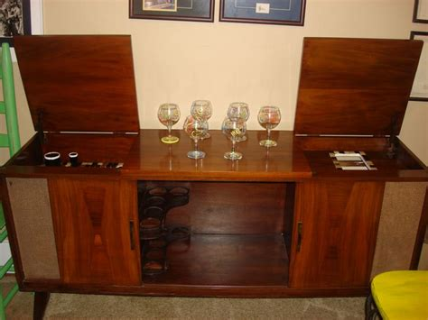 A 1960's console stereo re purposed into a bar. Visit me