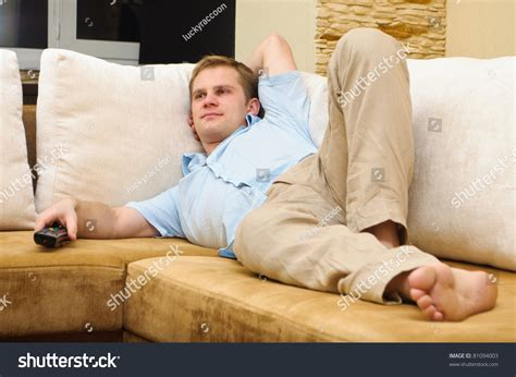 Lying On A Sofa by Lying On Sofa Tv Stock Photo 81094003