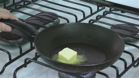 1 Knob Of Butter by A Knob Of Butter Is Put Into A Fry Pan And Melts