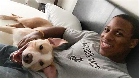 city dogs cleveland cleveland browns terrell watson adopts a pit bull and they both can t stop smiling