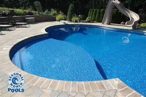 Images Of Backyards With Pools Sun Decks Steel Wall Seasonal World