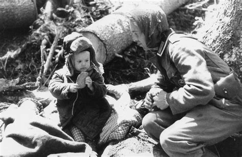 film horor german german soldier giving bread to an orphaned russian boy 1942