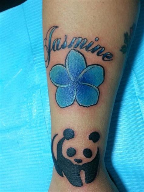panda flower tattoo panda with blue jasmine flower tattoo on forearm