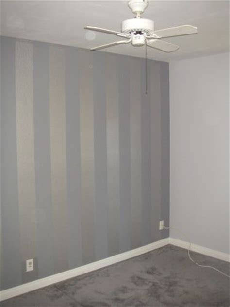light grey walls w flat finish accented by a metallic silver and flat grey striped wall