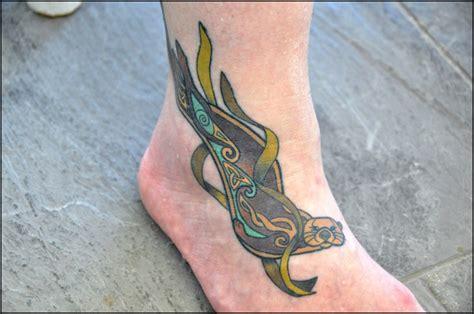 sea otter tattoo aon celtic