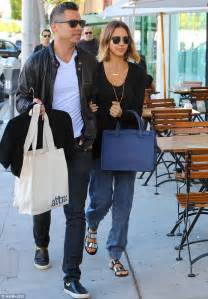 jessica alba links arms with husband cash warren as they