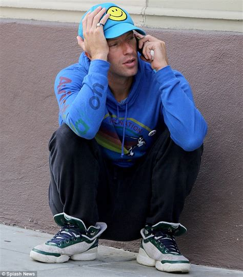 Why Is Millionaire Coldplay Chris Martin Sleeping by Chris Martin S Troubled Mood Clashes With His Smiley Cap