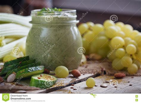 Premix Grape Milkshake Grape Blended 1kg fresh organic green smoothie with cucumber parsley grapes and celery stock image