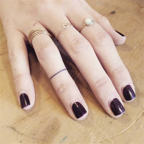 ring finger tattoo removal minimalist ring on the right ring finger