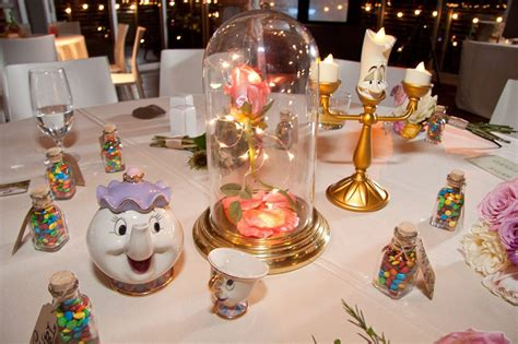 themed table centerpieces each table at this couple s wedding was inspired by a