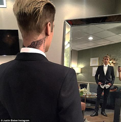 justin bieber divine tattoo justin bieber summoned tattoo artist to luxury miami