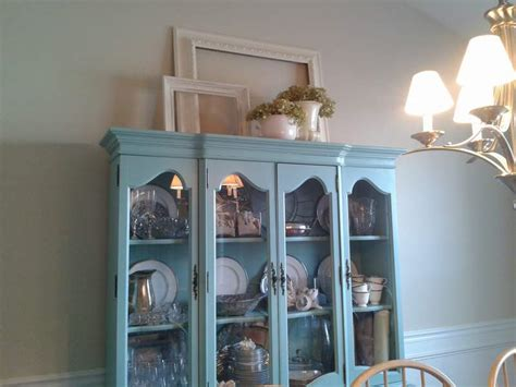 how to decorate on top of cabinets with vaulted ceiling rearranging the top of the china cabinet cclem