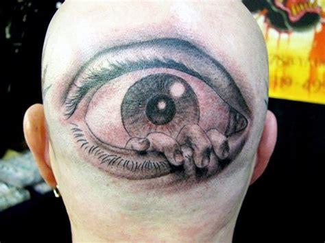 tattoo eyes white horrifying like painted black and white eye with hand