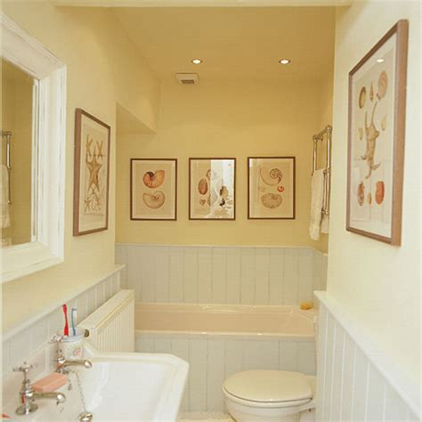 yellow bathroom with white suite and tongue and groove