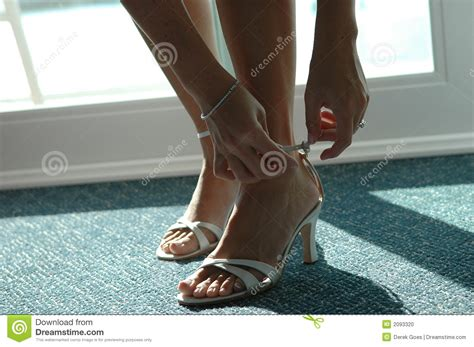 putting on shoes putting on shoes stock photo image 2093320