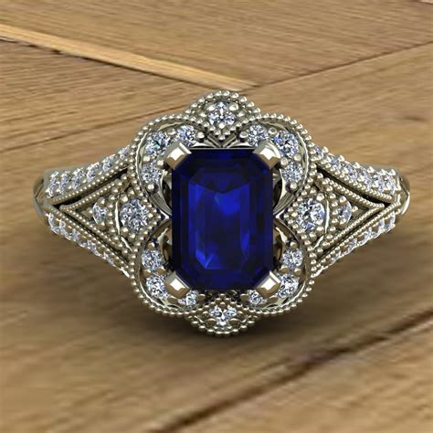 blue sapphire engagement ring emerald cut scallop