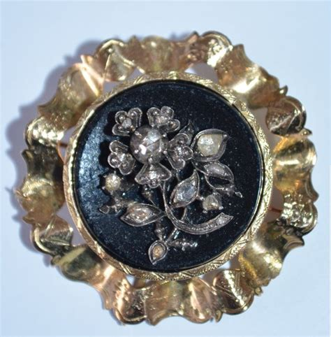 Set Cur yellow gold brooch set with a silver flower with 13