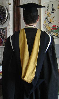 Faculty Of Yellow academic dress of of melbourne