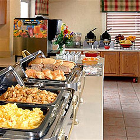 hotels with free breakfast buffet amenities hawthorn by wyndham suites west akron ohio oh
