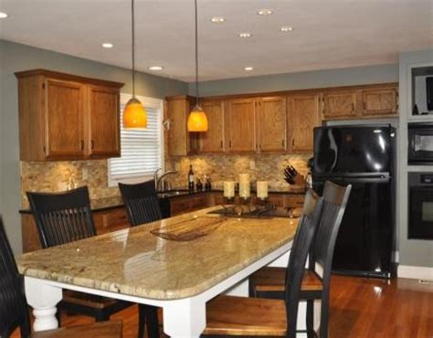 Grey walls, oak cabinets and floor, dark wood accents