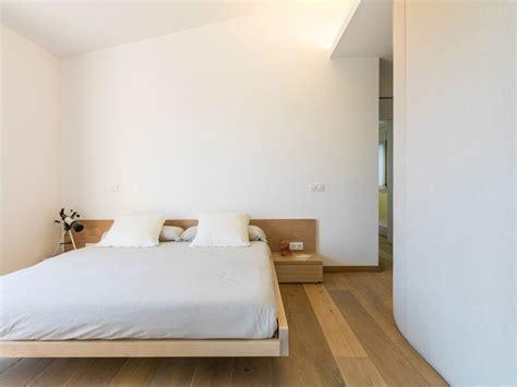 concrete home combines earth tones  minimalist aesthetic